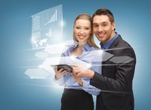 Man and woman with virtual screens Royalty Free Stock Images