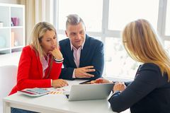 Man and woman visiting financial adviser royalty free stock photo