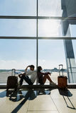 Man and woman waiting for flight Stock Photo