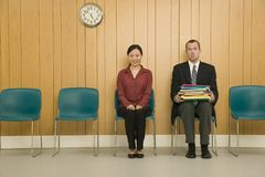 Man and Woman in Waiting Room Stock Photo