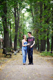 Man and woman on a walk. In the park Stock Photos