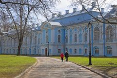 Man and woman on a walk in the courtyard of the Smolny Cathedral Royalty Free Stock Photo
