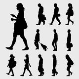 Man and Woman Walk Silhouettes. Black walk silhouettes  set on gray background Stock Photography