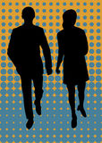 Man and woman walking. In stylish outfit, silhouettes with pop background Royalty Free Stock Photography