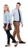 Man and woman walking. A men passing by a walking women and casting a sly glance at her Stock Images