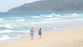 Man and woman walking along the seashore. Couple resting on the beach. stock video footage