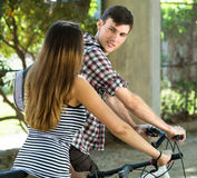 Man and woman walking  with bicycles Stock Photos