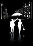 Man and woman walking in the city at night in the  Royalty Free Stock Photos