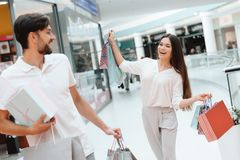 Man and woman are walking from one to another store in shopping mall. royalty free stock images