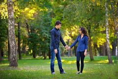 Man and woman walking in the park Royalty Free Stock Photography
