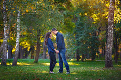 Man and woman walking in the park Stock Photography