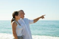 Man and   woman  walking at  sea Stock Photo