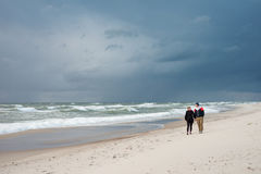 Man and a woman walking on the sea Stock Image