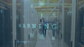 Man and woman walking in server room with moving data security messages. Animation of a Caucasian man and woman walking down a corridor between mainframe stock footage