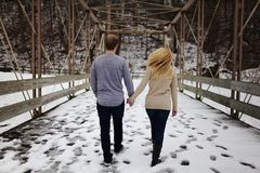 Man and Woman Walking on Snow Covered Road Royalty Free Stock Photos