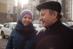 Man and woman walking on street and talking. Daughter and dad walk the streets, they are happy to meet and happily look at each other Royalty Free Stock Photography