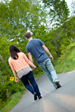 Man and Woman Walking in Street Stock Photos