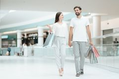 Man and woman are walking to another store in shopping mall. stock photo