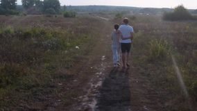Man and woman walking view from the air stock video footage
