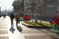 Man and Woman walks in the centre of Minsk and celebrate 9 may victory day royalty free stock photography
