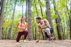 Man and woman warming up and stretching before exercise Stock Photos