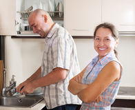Man and woman washing dishes Stock Photo