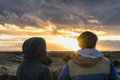 A man and woman watching the sunset Royalty Free Stock Image