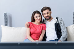 Man and woman watching tv on couch Royalty Free Stock Photo