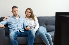 Man and woman watching TV stock image