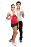 Man and woman with water after workout Stock Image