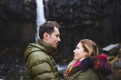 Man and Woman at Waterfall Royalty Free Stock Photos