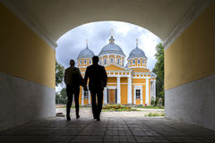 A man and a woman on the way to the Church in Tver, Russia. Young couple walking in the direction of the Russian church in Tver, Russia royalty free stock photography