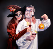 Man and woman wearing as vampire and witch. Halloween. Couple wearing as zombie and witch. Halloween stock photos
