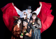 Man and woman  wearing  as  vampire and witch. Halloween. Group of people  wearing  as  vampire and witches, joker and dead bride. Halloween Royalty Free Stock Image
