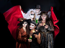 Man and woman  wearing  as  vampire and witch. Halloween. Group of people  wearing  as  vampire and witches, joker and dead bride. Halloween Stock Photos
