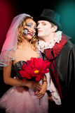 Man and woman  wearing  as  vampire and witch. Halloween. Man and women  wearing  as  vampire and Chucky Stock Images