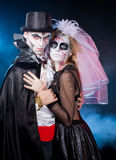 Man and woman  wearing  as  vampire and witch. Halloween. Young couple wearing  as  vampire and  dead bride. Halloween Royalty Free Stock Photography
