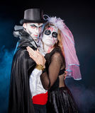 Man and woman wearing as vampire and witch. Halloween. Young couple wearing as vampire and dead bride. Halloween royalty free stock image