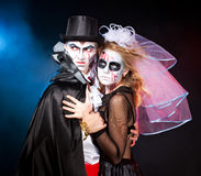 Man and woman  wearing  as  vampire and witch. Halloween. Young couple wearing  as  vampire and  dead bride. Halloween Stock Photo