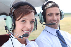 Man and woman wearing headsets Stock Photo