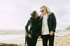 Man and Woman Wearing Jackets Near Seaside Under Cloudy Sky royalty free stock image