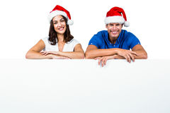 Man and woman wearing Santa hat Royalty Free Stock Image