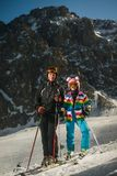 Man and Woman Wearing Snow Ski Suit and Snow Ski With Poles during Snow Royalty Free Stock Photography