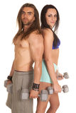Man and woman with weights back to back Stock Photography