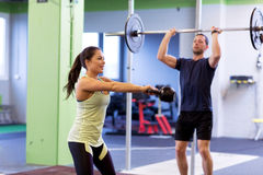 Man and woman with weights exercising in gym Royalty Free Stock Images