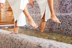 Man and woman while wellness water treading. Man and women while wellness water treading or hydrotherapy, only feet to be seen Stock Photography