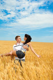 Man and woman in wheat Royalty Free Stock Image