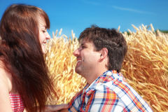 Man and woman on a wheat field Stock Image