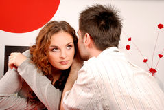 Man and woman whispering Royalty Free Stock Photo