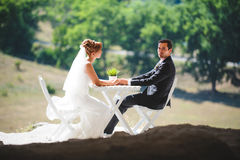 Man and Woman at White Table. Man and women at white table on hill Stock Photos